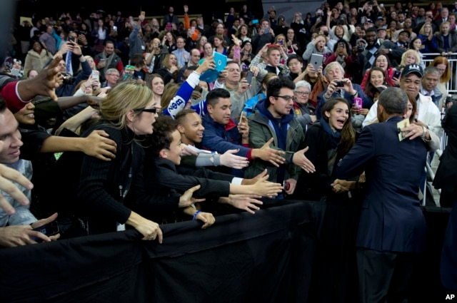 President Obama greets people in the audience after speaking at University of Nebraska-Omaha, Jan. 13, 2016.