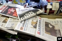 Newspaper headlines show Italian Premier Matteo Renzi's resignation following the result of a constitutional referendum, at a newsstand in Rome, Dec. 5, 2016.