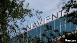 FILE - Signage is seen on the offices of Navient in Wilmington, Delaware, June 9, 2021.