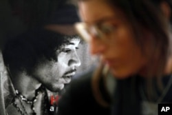 FILE - A photograph of late U.S. musician Jimi Hendrix decorates an office of the Handel House Museum, in what used to be the star's bedroom when he was living in the house during late 1960s, in central London's Mayfair area, Aug. 24, 2010.