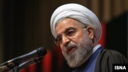 FILE - With the sudden death of Iranian President Hassan Rouhani's mother, the country's negotiators on an international nuclear arms deal left Switzerland Friday. Talks are set to resume next week.