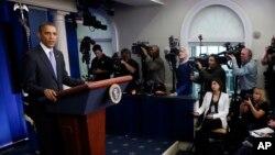 """Presiden Barack Obama dalam konferensi pers menjelang akhir tahun di ruang khusus wartawan """"Brady Press Room"""" di Gedung Putih (20/12)."""