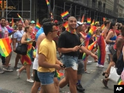 Participants march in the 2018 Gay Pride Parade in New York City, June 24, 2018.