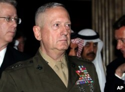 U.S. Gen. James Mattis, commander of U.S. Central Command, walks with other delegates, Dec. 4, 2010, at the International Institute for Strategic Studies' global security forum in Manama, Bahrain.