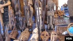 West African masks are displayed by Moses Camara at Eastern Market, in Washington D.C.. (file) (VOA/Elizabeth Monnac)