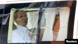 FILE - Thailand's King Bhumibol Adulyadej is seen sitting in a vehicle as he leaves Siriraj Hospital for the Grand Palace to join a ceremony marking Coronation Day in Bangkok, Thailand, May 5, 2015.