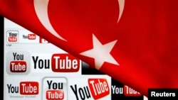 YouTube logos displayed on a laptop screen partially covered with Turkey's national flag in this photo illustration taken in Ankara March 27, 2014.