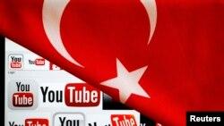 Logo của YouTube trên màn hình của một máy tính xách tay, ở Ankara, bị che một phần bởi quốc kỳ của Thổ Nhĩ Kỳ