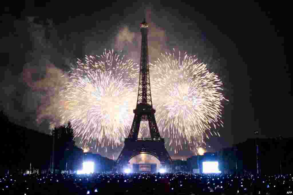 July 14: The Eiffel Tower is illuminated during the traditional Bastille Day fireworks display in Paris.REUTERS/Gonzalo Fuentes