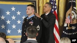 President Barack Obama awards US Army Sergeant First Class Leroy Arthur Petry of Santa Fe, New Mexico the Medal of Honor for his valor in Afghanistan, July 12, 2011