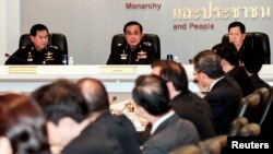 Thai Army chief General Prayuth Chan-ocha speaks during a meeting with Thai ambassadors at the Royal Thai Army Headquarters in Bangkok, June 11, 2014.