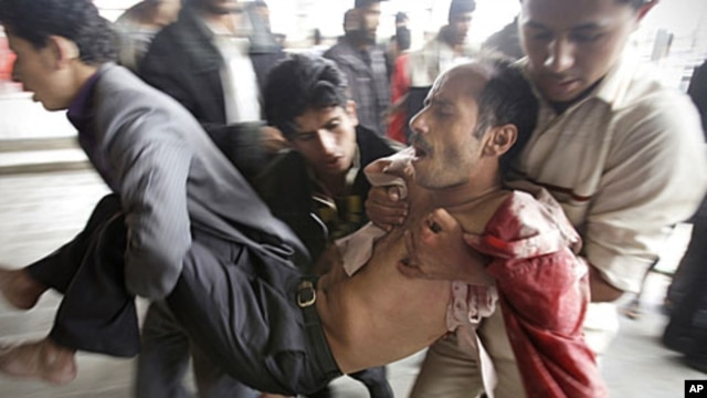 A wounded protestor is carried from the site of clashes with security forces in Sana'a, Yemen, November 24, 2011.