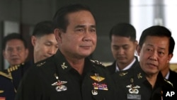 FILE - Thailand's Army commander Gen. Prayuth Chan-ocha, left, arrives at the Royal Thai Army Club in Bangkok, Thailand.
