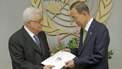 Palestinian President Mahmoud Abbas, left, gives a letter requesting recognition of Palestine as a state to Secretary-General Ban Ki-moon during the 66th session of the General Assembly at United Nations headquarters Friday.
