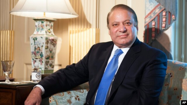 Pakistan Prime Minister Nawaz Sharif looks towards photographers as he meets with Secretary of State John Kerry at the State Department in Washington, Oct. 20, 2013.