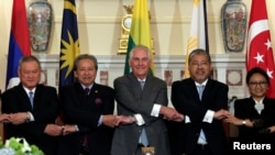 U.S. Secretary of State Rex Tillerson, center, poses with ASEAN foreign ministers before a working lunch at the State Department in Washington, U.S., May 4, 2017.
