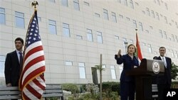 US Secretary of State Hillary Rodham Clinton, talks to staff of the U.S. embassy in Abu Dhabi, United Arab Emirates, Jan 10, 2011
