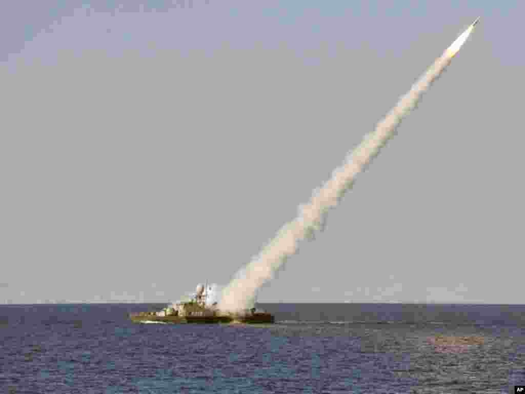 In this image made available by the Iranian Students News Agency, an Iranian navy vessel launches a missile during a on January 1, 2012. (AP)