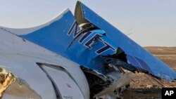 This photo shows the tail of a Metrojet plane that crashed in Hassana, Egypt on Saturday, Oct. 31, 2015.