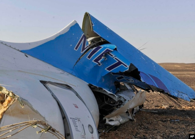 The tail of a Metrojet plane that crashed in Hassana, Egypt on Saturday, Oct. 31, 2015.