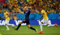 Arjen Robben of the Netherlands controls the ball ahead of Brazil's Luiz Gustavo during the third-place playoff at the Brasilia national stadium.