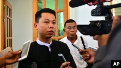 FILE - Arnt Khaung Min, deputy chief editor of the weekly Myanmar Herald, speaks to journalists as he leaves a township court in Naypyitaw, Myanmar, July 21, 2015. He and the paper's chief editor Kyaw Swa Win were fined for violating the media law by printing articles affecting an individual's reputation.