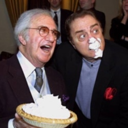 Comedian Soupy Sales with fellow comedian Pat Cooper during a party honoring his 75th birthday at the Friar's Club in New York.