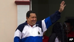 Venezuela's President Hugo Chavez waves to supporters from Miraflores presidential palace at an event marking the 10th anniversary of his return to power after a failed coup in Caracas, Venezuela, April 13, 2012 (file photo).