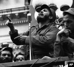 FILE - Rebel leader Fidel Castro draws a laugh from the crowd in the street as he makes a speech in Colon, Jan. 7, 1959.
