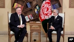 FILE - U.S. Secretary of State Mike Pompeo, left, meets with Abdullah Abdullah the main political rival of President Ashraf Ghani at the Sepidar Palace, in Kabul, Afghanistan, March 23, 2020.