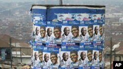 An advertisement tank is plastered with posters of former military ruler Muhammadu Buhari and his running mate Tunde Bakare during the Congress for Progressive Change (CPC) presidential campaign rally at Mapo square, Ibadan.