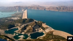 FILE - Pakistan's biggest Tarbela Dam is observed from a helicopter in Tarbela, Nov. 18, 2018. Cash-strapped Pakistan should pursue clean energy instead of relying on coal, nuclear and hydroelectric power, according to a report release on Dec. 5, 2018.