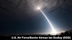 FILE - An unarmed Minuteman III intercontinental ballistic missile launches during an operational test at Vandenberg Air Force Base, California, Feb. 26, 2016.