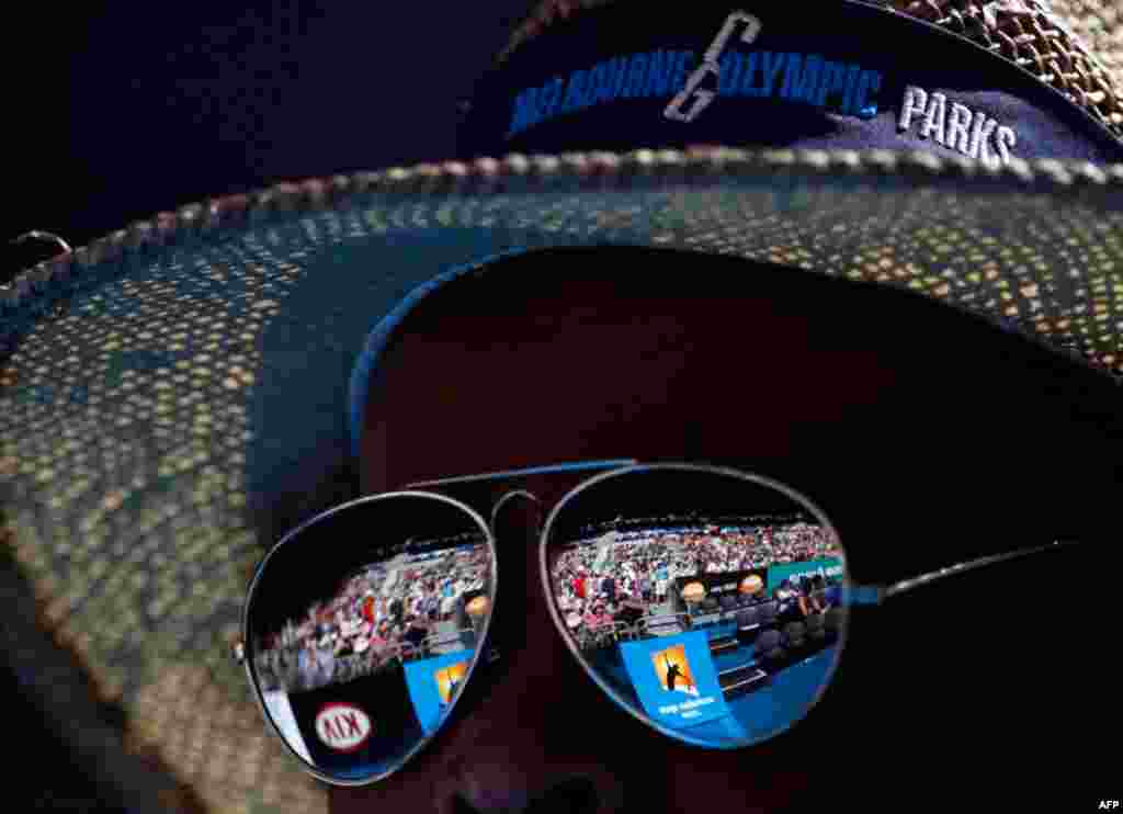 January 21: The crowd at the Hisense Arena is reflected on the sunglasses of a spectator during the match between Maria Sharapova of Russia and Julia Goerges of Germany at the Australian Open tennis tournament in Melbourne. (Reuters/Petar Kujundzic)