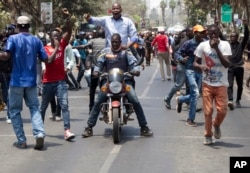 National Super Alliance (NASA) protesters made a dramatic entry into the CBD as they marched to the IEBC - Independent Electoral and Boundaries Commission offices, in Nairobi, Kenya, Oct. 6, 2017.