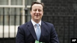 British Prime Minister David Cameron leaves 10 Downing Street to attend Prime Minister's Questions at the House of Commons in London, February 02, 2011