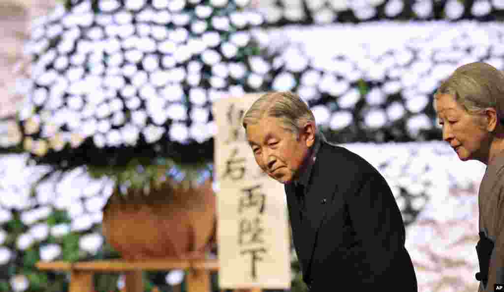 Japanese Emperor Akihito and Empress Michiko leave the national memorial service for the victims of the March 11, 2011 earthquake and tsunami in Tokyo, March 11, 2013.