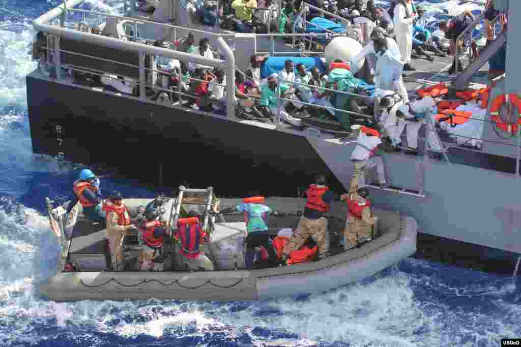 Distressed persons are transferred from the amphibious transport dock ship USS San Antonio (LPD 17) to Armed Forces of Malta offshore patrol vessel P52 in the Mediterranean Sea. San Antonio provided food, water, medical attention, and temporary shelter to the rescued.