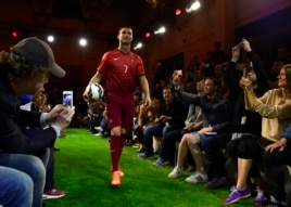 Portugal's football team forward Cristiano Ronaldo arrives to an interview during the presentation of new Nike football boots in Madrid, April 25, 2014.