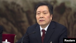 FILE - Communist Party Secretary of Hebei province Zhou Benshun speaks at a session of the National People's Congress (NPC) in Beijing, China, March 7, 2015.