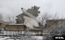 Wreckage of the plane can be seen after the crash in Kygryzstan, Jan. 16, 2017.