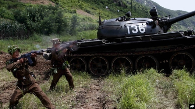 North Korean soldiers from the historic 105 tank unit fire during a military exercise at an undisclosed location in North Korea, on July 27, 2012, marking the 59th anniversary of the armistice that ended the 1950-53 Korean War.