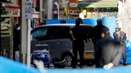 Cảnh sát đứng cạnh chiếc xe đâm khách bộ hành vào ngày đầu năm mới ở Tokyo, Nhật Bản, ngày 1 tháng 1, 2019.