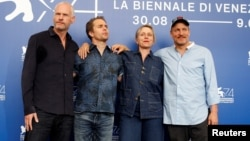 "Director Martin McDonagh, actors Sam Rockwell, Frances McDormand and Woody Harrelson pose during a photocall for the movie ""Three Billboards Outside Ebbing, Missouri"" at the 74th Venice Film Festival in Venice, Italy, Sept. 4, 2017."