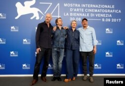 "FILE - Director Martin McDonagh, actors Sam Rockwell, Frances McDormand and Woody Harrelson pose during a photocall for the movie ""Three Billboards Outside Ebbing, Missouri"" at the 74th Venice Film Festival in Venice, Italy, Sept. 4, 2017."