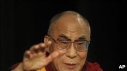 Tibetan Spiritual leader the Dalai Lama gestures while giving a talk in New Delhi, India, Wednesday, Aug. 10, 2011.