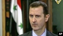 Syria's President Bashar al- Assad during an interview broadcast on Al-Manar Television on May 30, 2013.