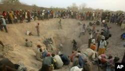 FILE - Gangs of illegal miners dig for diamonds in Marange, eastern Zimbabwe, Nov. 1, 2006.