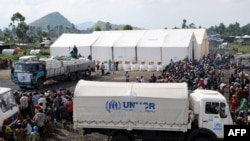 Internally displaced people (IDPs) await food distribution from the UNHCR. (File)