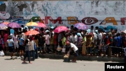 Evacuees queue for relief goods in a sports stadium which has been turned into an evacuation center Zamboanga, Sept. 20, 2013.